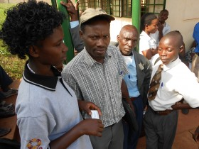 Image: Activists from Kibaale District wait to hear the court ruling