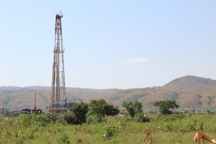 This is as close as one can approach the Ondiek oil well without attracting the attention of security guards.  (NY)