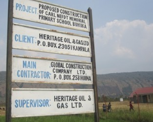 A signpost at the entrance  of a school built by Heritage Oil and Gas in Buhukya, Hoima District in the area that hosts the Kingfisher Oil wells