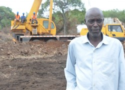 Luteganda Erinya at the construction site of a new  police station. He says that the