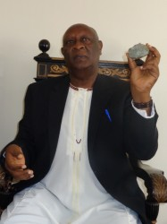 The King of Bunyoro, His Majesty Solomon Gafabusa Iguru displays a precious stone. The Kingdom hopes to use royalties to boost household incomes in the Region (Photo: Francis Mugerwa)