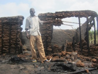 James Agenonga ponders his next move after his house was burnt to the ground (Photo: S. Mwesigye)