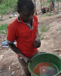 A Mubende miner displays mercury (Photo: C. Musiime)
