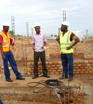 Fred Musinguzi with Tullow Officials at the construction site of the Kyehoro health centre. (Photo: F.Mugerwa)