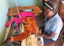 A blind student of tailoring attending internship training (Photo: Courtesy of Living Earth)