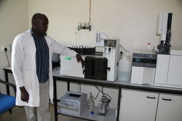 Makerere University trained chemist, Andrew Wedulo, shows off equipment in the Enviroserve lab. (Photo: Nick Young)