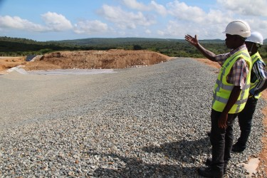 Enviroserve Landfill Manager, Joel Ogarubo, shows a doubly lined pit that will be filled with stabilised wastes.  At total of eight such pits are planned for the site. (Photo: Nick Young)