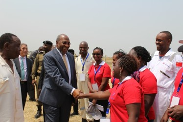 Dr. Rugunda being welcomed by CNOOC officials. (Photo: F. Mugerwa)