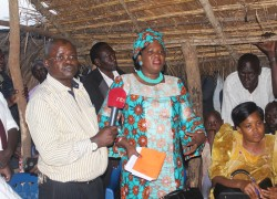 Lands-Minister-Betty-AmongiC-with-Hoima-RDC-Isaac-Kawooyaleft-and-the-Hoima-woman-MP-Tophas-Kaahwa-at-Rwamutonga-village-in-Hoima.Photo-by-Francis-Mugerwa