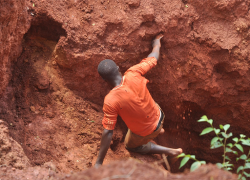 youth miner entiring a pit