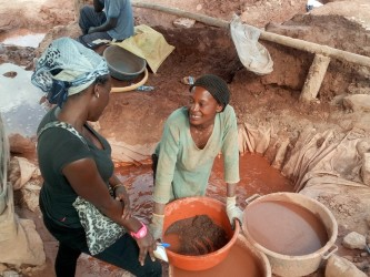 Ms Jessica Mbalina, an artisan miner in Mubende washes dust in mercury in search of gold