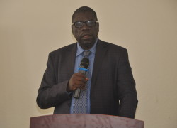 Zachary Baguma, the director in the Directorate of Geology addressing the miners
